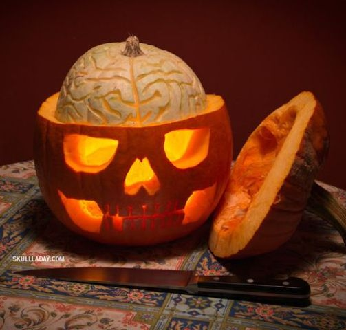 pumpkin skull with an exposed squash brain