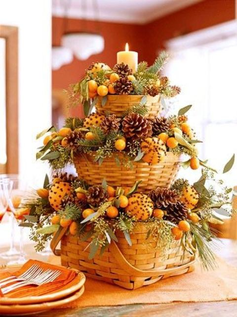 tiered centerpiece of baskets with pomanders, pinecones and fir branches