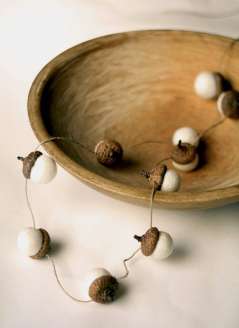 make acorns of felt and attach them to twine