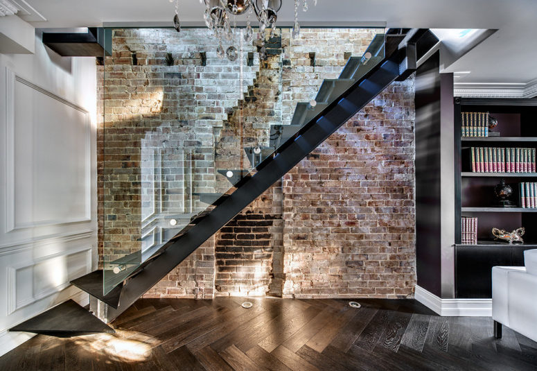 a modern staircase made of glass and metal would look great against a really rough wall made of damaged bricks