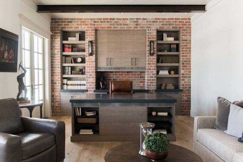 even faux brick wall makes a home office looks masculine (Remedy Furniture & Design Center)