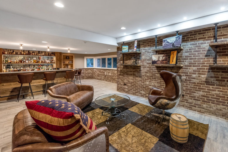 a basement bar would look great with rough walls (DESIGNfirst  Builders)