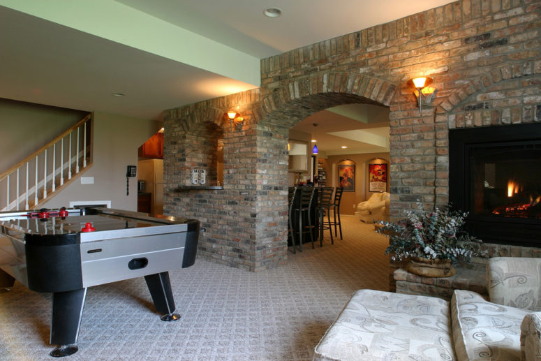 a billiard room with a fireplace should definitely feature a brick wall