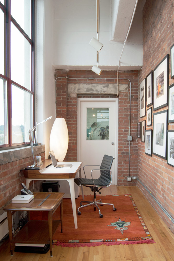a brick wall is a perfect idea for a loft-style home office