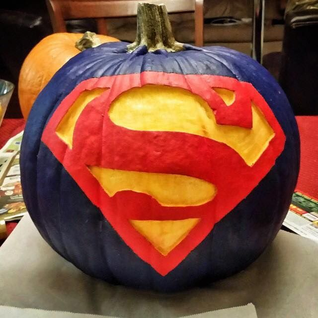 A cool mix of painting and carving can create a beautiful Superman pumpkin