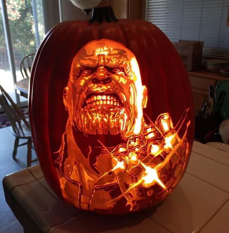 An amazing Thanos pumpkin carving with all infinity stones that are glowing