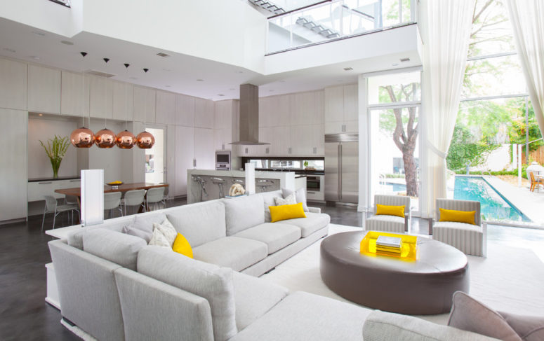 Pillows is the easiest way to add yellow touches to any interiors. (Laura U, Inc.)