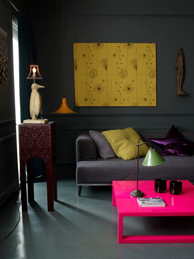 Yellow wall artworks looks great on grey walls. (Abigail Ahern)