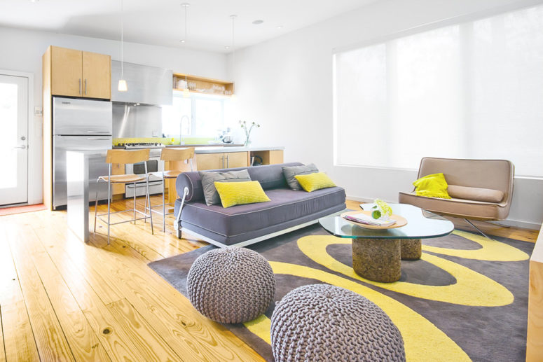 Natural wood works with a gray and yellow color combo quite well. (Intexure Architects)