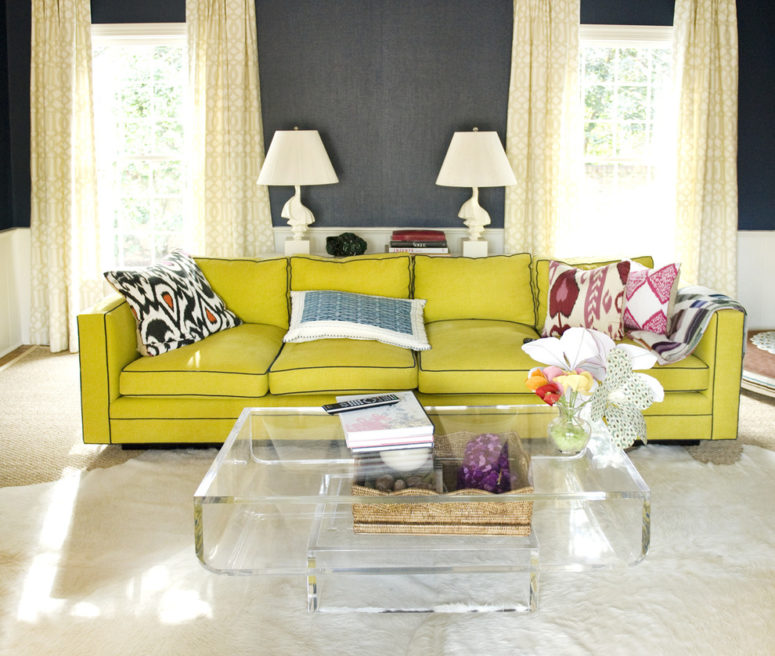An yellow sofa would make a statement in any grey living room.