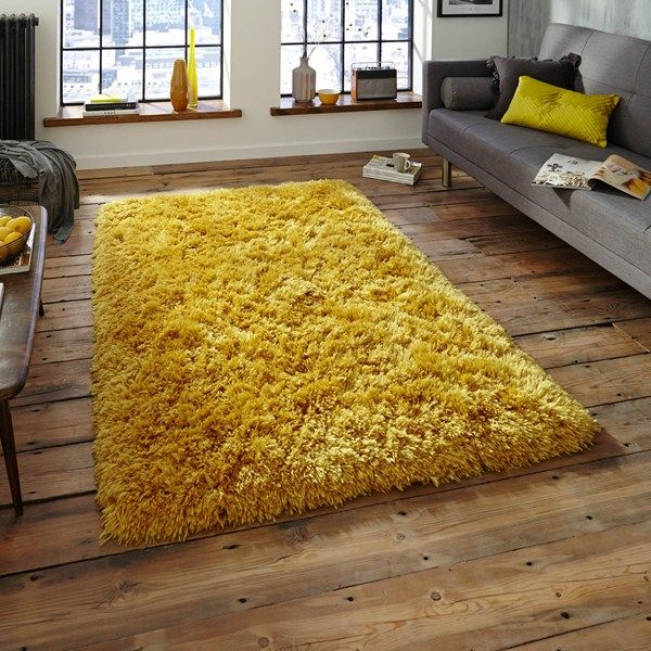 A bright yellow shaggy rug would look well by a grey sofa.