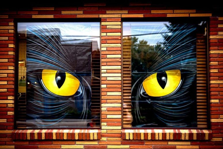 a large watching monster is a perfect way to decorate two windows that are close by