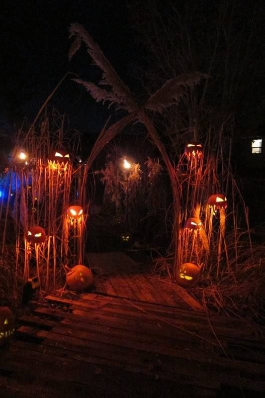 welcome treat or treaters in a really scary way with an arch surrounded by scary jack-o-lanterns