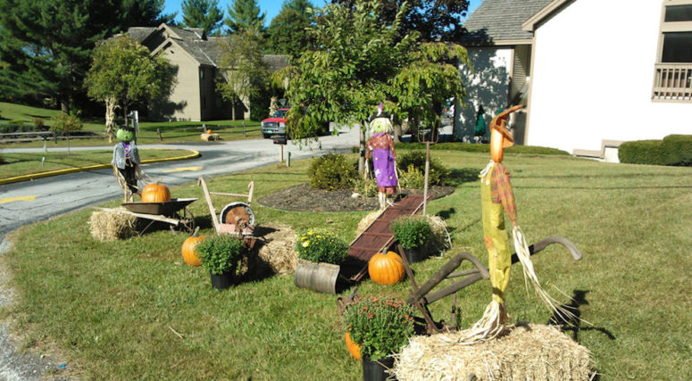 scarecrows doing your lawn is another cool and not traditional option for front yard halloween decor