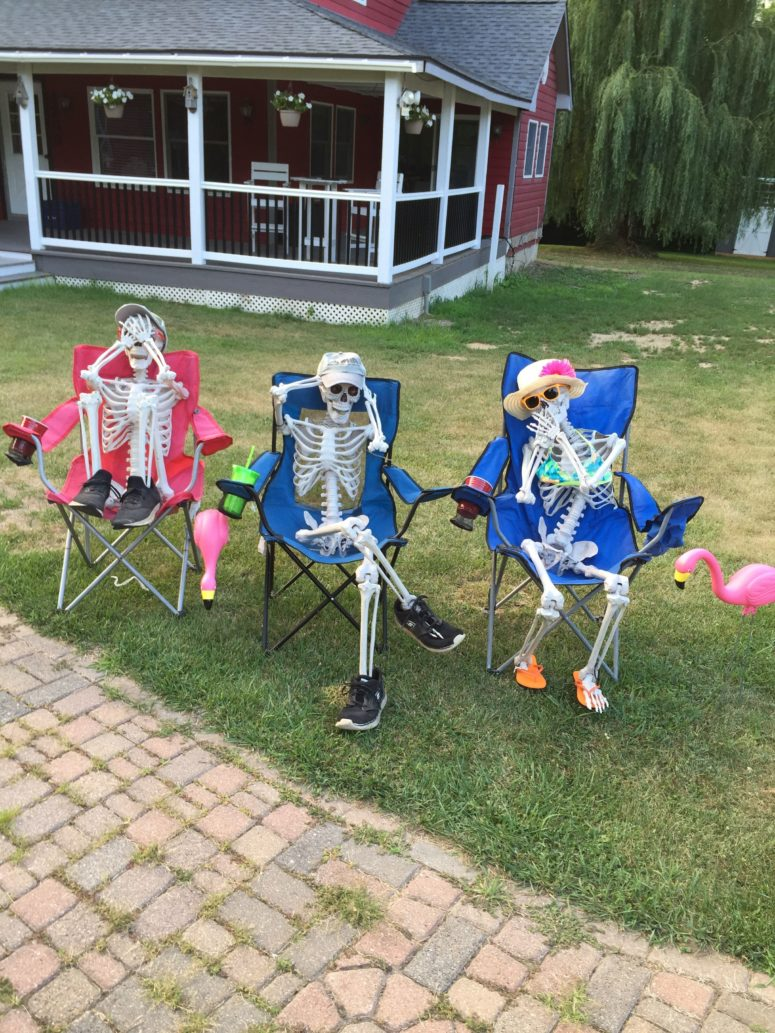 skeletons trying to get a sunburn is a cool idea for those who has lots of sunshine during this time of the year