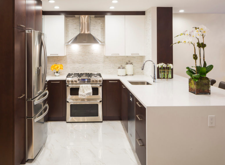 a waterfall countertop makes the whole kitchen looks less bulky (Vi-Design)
