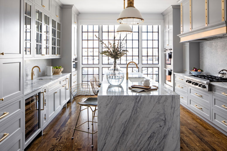 marble is a great choice for a waterfall countertop that helps to make a kitchen island looks like a work of art (Bria Hammel Interiors)