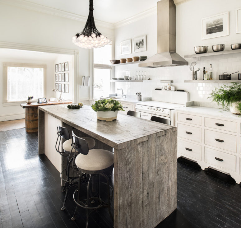 a reclaimed kitchen island adds a rustic flair to a contemporary kitchen (Antonio Martins Interior Design)