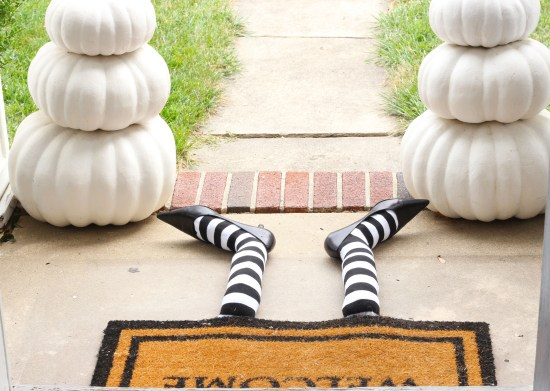 Cute DIY Witch Legs Doormat. This is an easy project to reuse an old pair of black heels, some striped socks and a bunch of plastic bags.  (via hellocentralavenue.com)