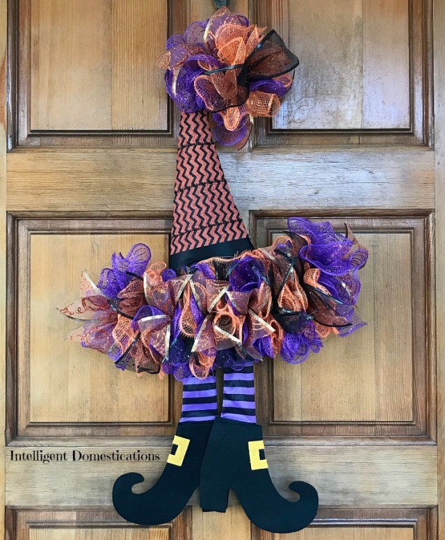 DIY Witch Hat Door Wreath. Get some dollar store supplies and follow this cool door wreath to add some cuteness to your halloween decor. (via intelligentdomestications.com)