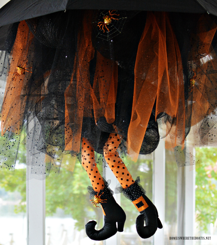 DIY Floating Umbrella Witch. Buy a pair of witch legs and reuse an old umbrella to create a beautiful hanging piece of decor. (via homeiswheretheboatis.net)