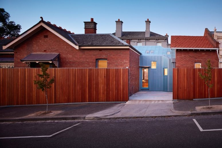 Brick Family House With Glazed Intervention