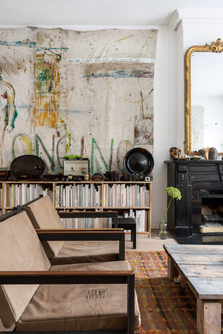 This eclectic home belongs to an artist, and it features a lot of his works and industrial details