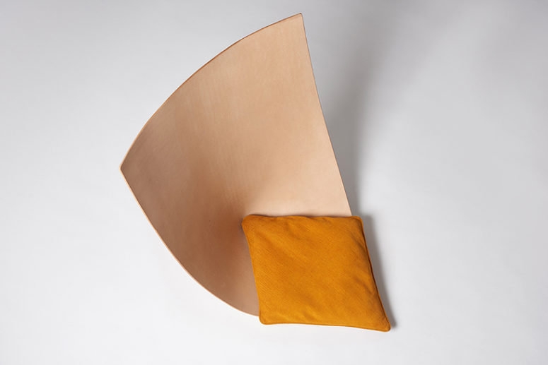 Each chair is a single leather piece shaped as a seat, and there are matching pillows for comfort