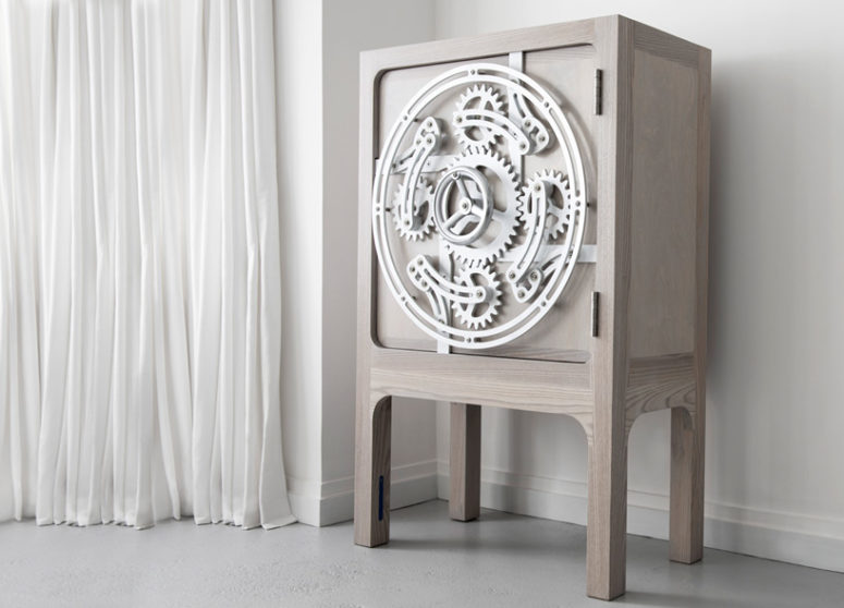 It looks like a usual light-colored cabinet but the mechanism on the door is stunning and it really functions
