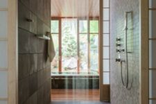 02 Japanese-styled bathroom in dark earthy colors, with a rain shower and wood floor