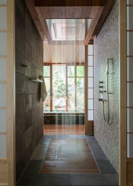 Japanese-styled bathroom in dark earthy colors, with a rain shower and wood floor