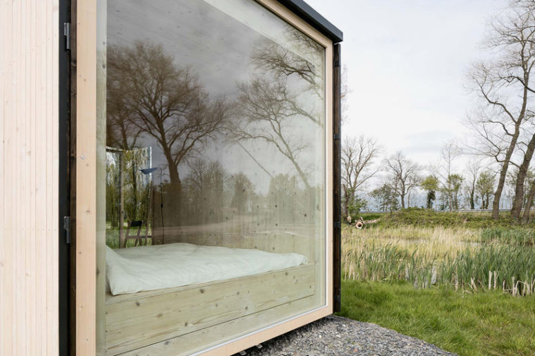 The Ark shelter has a large window, which allows enjoying the views right in a bedroom and brings much light in