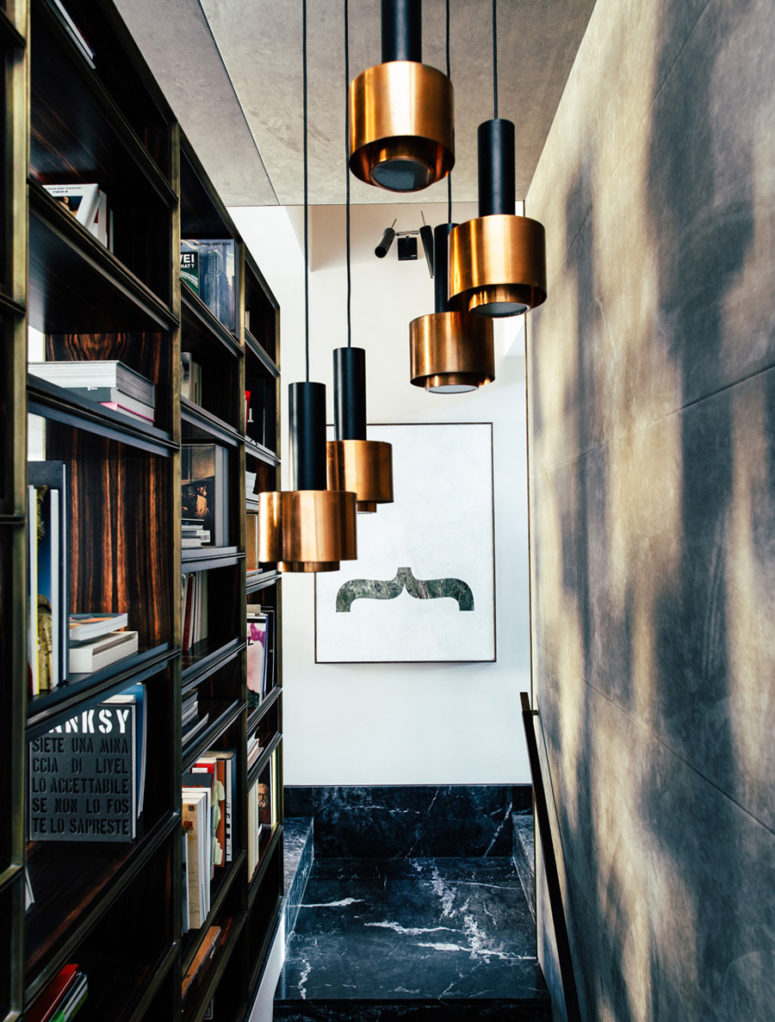 The architect used black marble in every space, and beautiful copper accents highlighted masculine decor