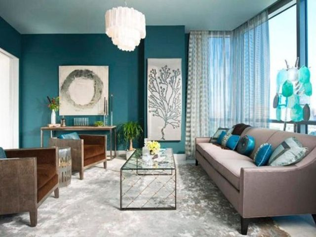 A Teal Accent Wall, Aqua Blue Accessories And Brown Upholstered Furniture