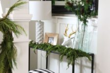 02 evergreen branches and garlands just scream winter, and so does a faux deer head
