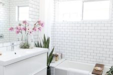 02 mid-century modern bathroom with white subway tiles on the walls and black hexagon ones on the floor