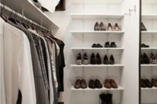 02 perfect minimalist closet layout with a leading rack on one wall, a mirror on the opposite wall and shoe shelves on the third one