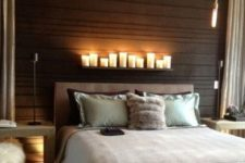 02 small LED lamps and pillar candles on the shelf above the bed