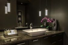 03 Asian-inspired space with dark cabinets and walls and chic pendant lamps