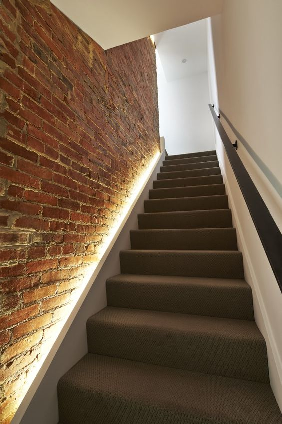 LED Lights Hidden In The Brick Wall To Line Up The Stairs