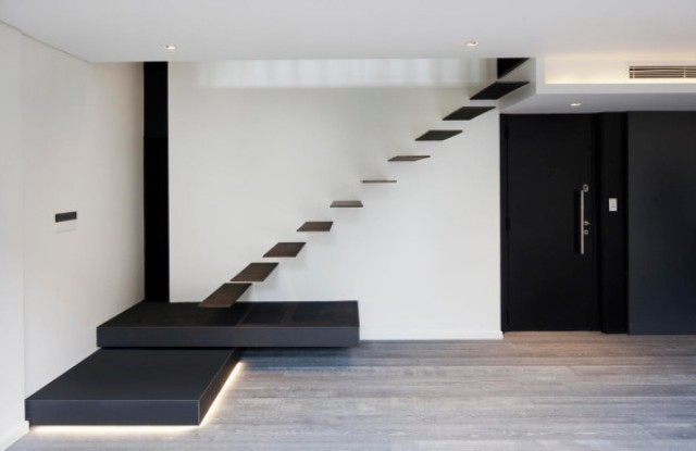 Simple black and white color scheme is enlivened with lighting