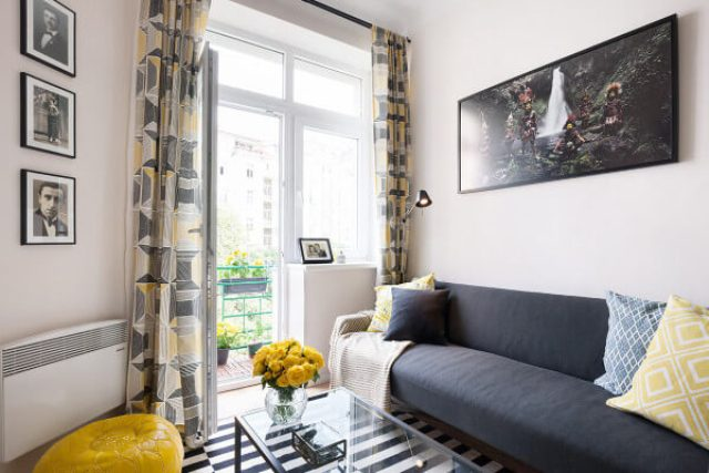 The decor is modern and eye-catchy, with bold yellow and aqua touches and a pallete of soft greys