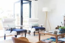 03 accentuate a neutral room with a jute rug and wicker furniture with navy textiles