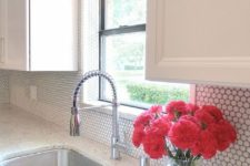 03 add a little texture to your backsplash with white penny tiles and grey grout