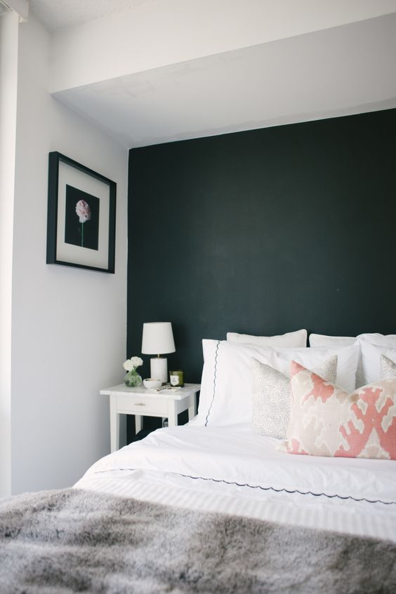 black headboard accent wall makes this niche cozier and more personal