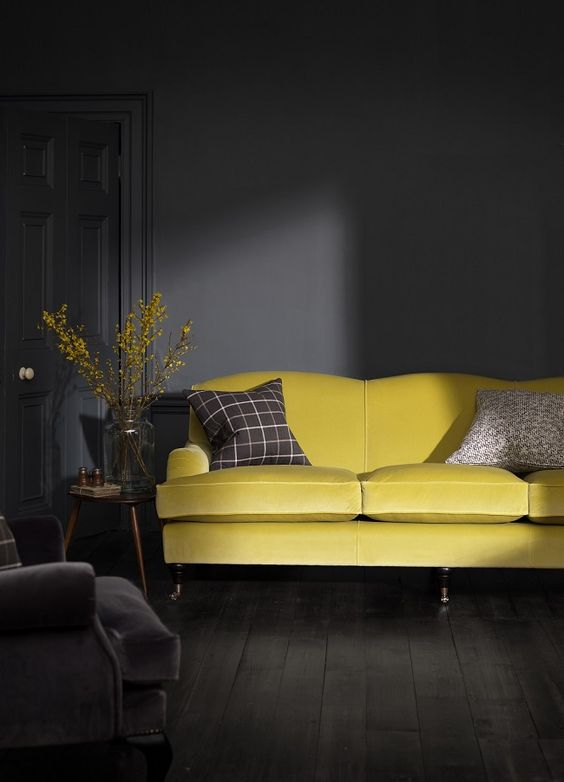 graphite living room with a sunny yellow sofa for an accent