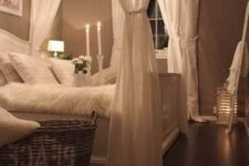 03 shabby chic bedroom with a crystal chandelier and candles for a soft glowing look