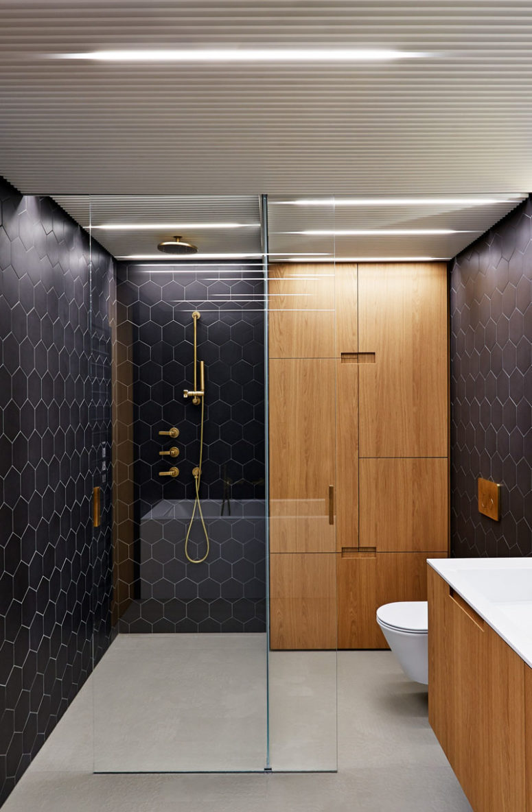 I love the wooden cabinetry with cavities instead of handles, they catch an eye and look very modern