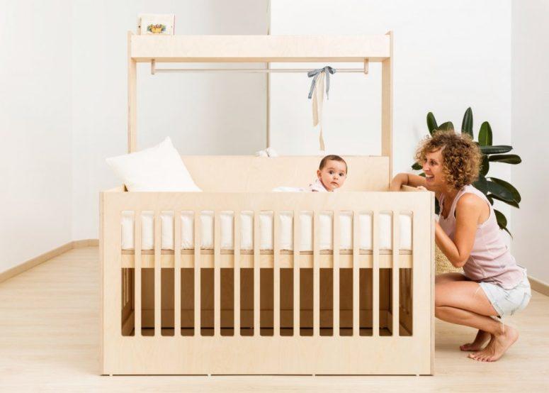 The Illeta crib has a cabinet for storage