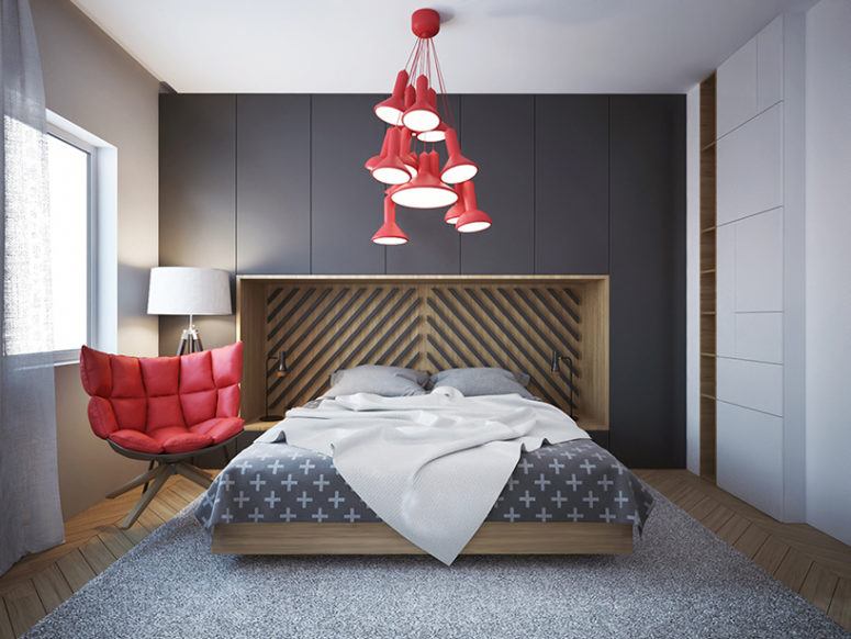 The bedroom is highlighted with red pendant lamps and a soft modern chair